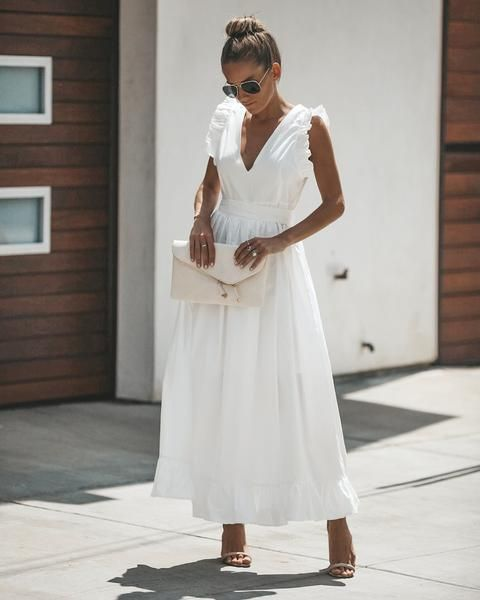 a gorgeous white cotton midi dress with a highlighted waist, ruffle cap sleeves, tan shoes and a white clutch