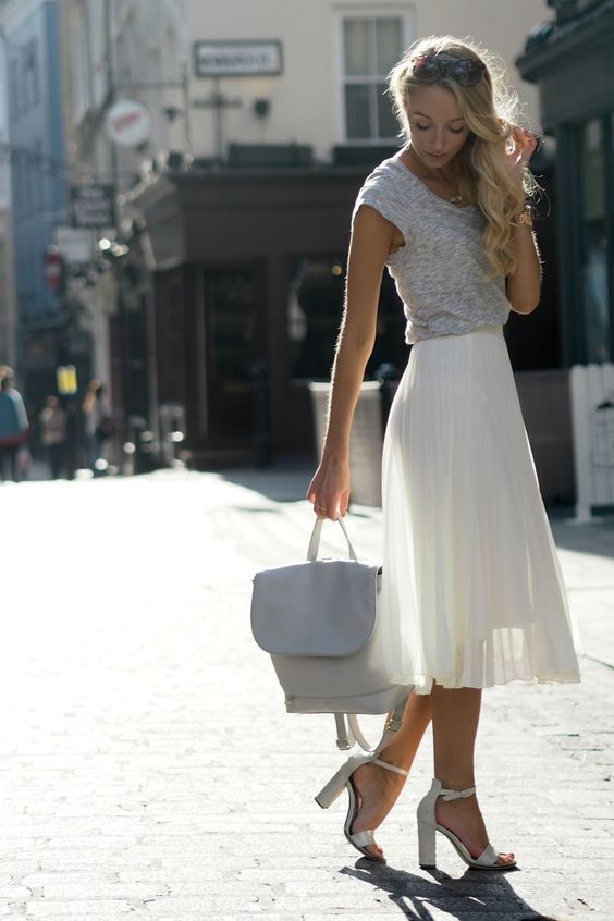 a grey tee, a white plated midi, white block heels and an off-white backpack to rock in summer