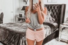 a grey tied up tank top and pink shorts for wearing at home in the summer