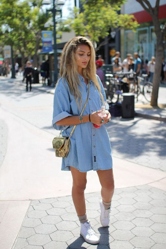 a light blue denim shirtdress with short sleeves, white sneakers and nude socks plus a gold bag