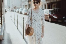 a light floral midi dress with short sleeves, black heeled mules and a wicker round bag to wear now