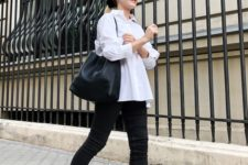 a monochromatic look with an oversized white shirt, black skinnies, black slingbacks and a large tote