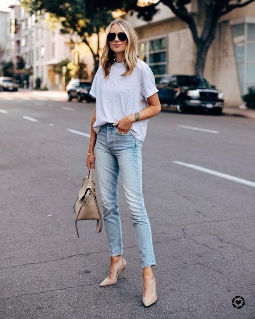 a neutral oversized tee, blue jeans, nude pointed toe heels and a neutral tote for work