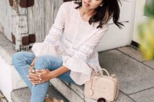 a neutral top with ruffle sleeves, blue skinnies, espadrilles, a blush bag and sunglasses