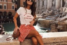 a printed t-shirt, a red printed skirt, two tone slippers, a brown bag for a trendy summer look