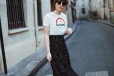 a printed tee, a black polka dot midi skirt, black heeled mules and trendy sunglasses