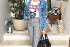 a printed tee, an oversized blue denim jacket, grey printed pants, white sneakers and a black bag