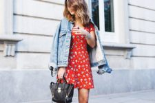 a red printed mini dress, a blue denim jacket, black block heels and a black bag with zips