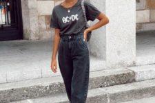 a rock look with a black printed tee, black baggy jeans, black heels and a black baguette bag