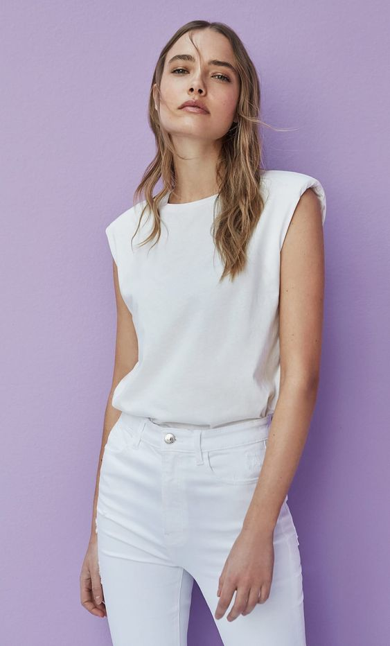 a simple minimal look with a white padded shoulder t-shirt and white jeans for this summer