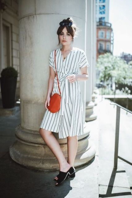 a simple striped summer wrap knee dress, a pink vintage-inspired bag and black heeled mules