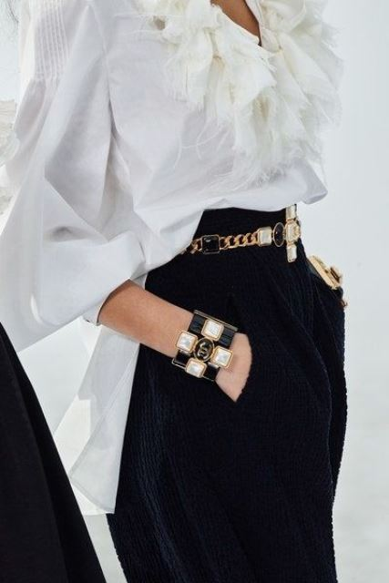 a statement black, white and gold bejeweled bracelet and a matching belt for accenting a monochromatic look