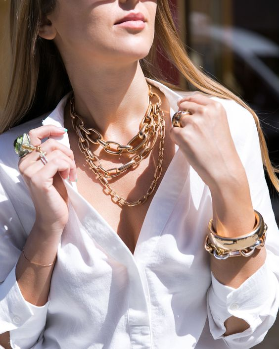 a statement chain necklace, a matching bracelet and a statement gold bracelet for a bold look