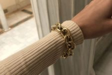 a statement gold chain bracelet – just add a matching choker and you'll look super trendy and bold