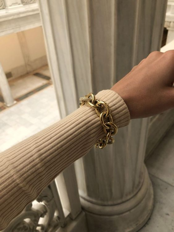a statement gold chain bracelet - just add a matching choker and you'll look super trendy and bold