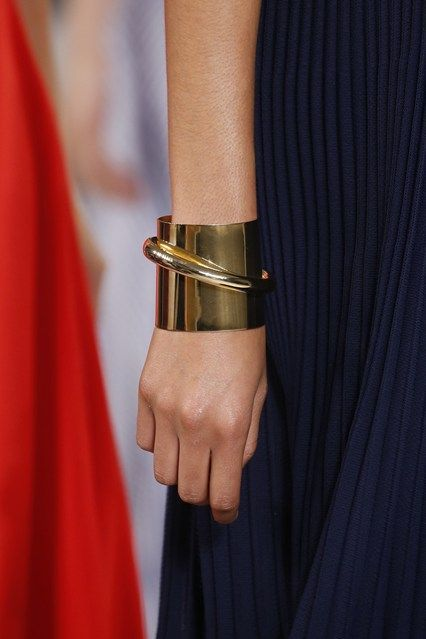 a statement minimalist bracelet in gold looks really unusual and bold and will elevate any outfit