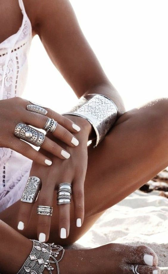 a statement silver bracelet, matching stacked rings and even an ankle chain for a bold gypsy or boho look
