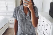 a striped romper styled as pajamas is a very cool and fresh take on traditional home looks