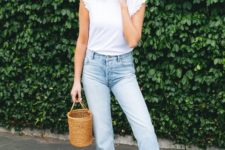 a stylish look with a white top with ruffle sleeves, blue jeans, brown slippers and a bucket bag
