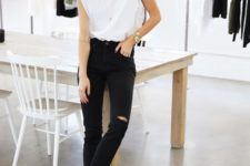 a stylish outffit with a white padded shoulder tee, black ripped jeans, black booties and layered neckalces