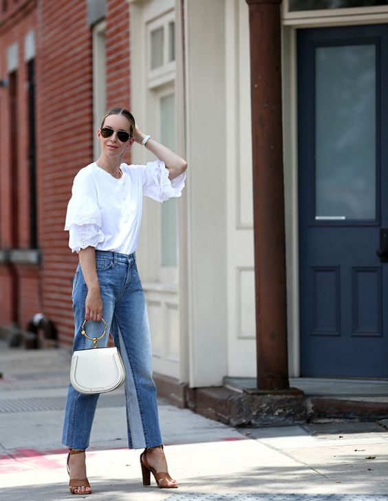 a stylish outfit with a white top with lace ruffle sleeves, blue jeans, tan shoes and a white bag