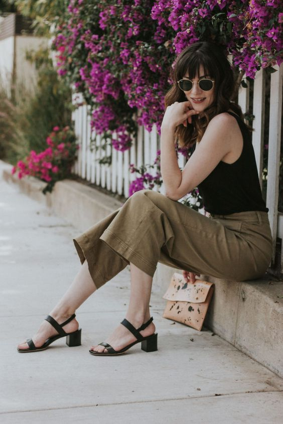 a summer look with a black top, tan cropped pants, black block heel sandals and trendy sunglasses
