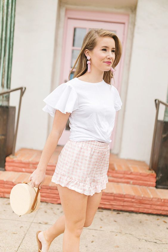 a summer look with a white ruffle sleeve top, pink plaid shorts, slippers and a small round bag