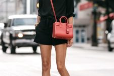 a total black look with a shirt, mini shorts, heels and a red bag for a summer party or date