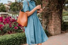 a trendy outfit with a blue denim knee dress, tan pointed toe flats and a brown tote