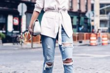 a white blazer, ripped blue jeans, white heeled mules and a white bag for a glam look