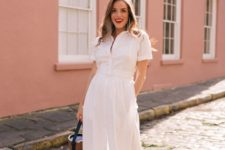 a white cotton button up maxi dress with short sleeves, a basket bag and red sandals