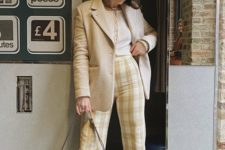 a white crop top, plaid pants, an oversized blazer, vintage-inspried shoes and a baguette bag in brown leather