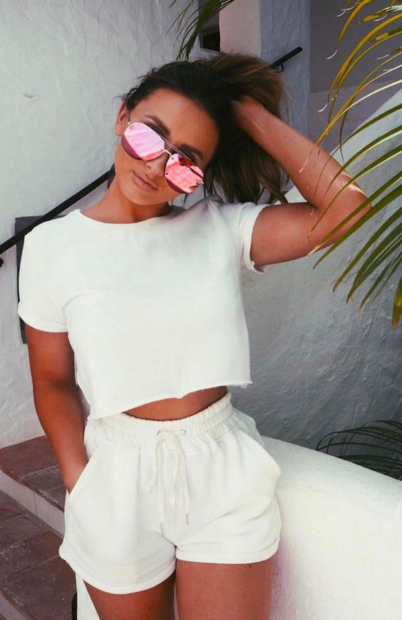 a white crop top, white shorts with pockets are a very comfy and sexy combo for wearing at home