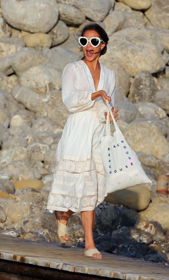 a white lace fitting midi dress with a boho chic feel, puff sleeves, neutral slippers and a large tote
