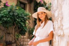 a white midi shirtdress with short sleeves, a vintage-inspired basket bag and a chic hat