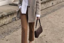 a white shirt, tan cropped pants, a grey oversized blazer, black moccasins and a chocolate brown baguette bag