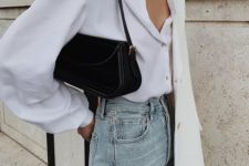 a white silk blouse, ligth blue jeans, an oversized white blazer and a black baguette bag