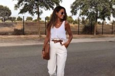 a white tank top, neutral pants, platform suede shoes and a brown bag for summer
