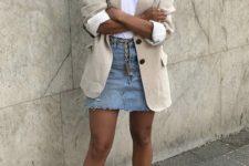 a white tee, a blue denim mini, a neutral blazer, black square toe sandals for a summer look