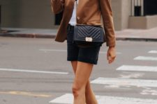 a white tee, black denim shorts, a cognac-colored blazer, two tone slingbacks and a black crossbody bag