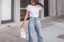 a white tee, blue jeans, fuchsia bow pointed toe shoes and a white bucket bag