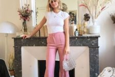 a white tee, pink fit and flare pants, white square toe sandals and a silver bag for a trendy look