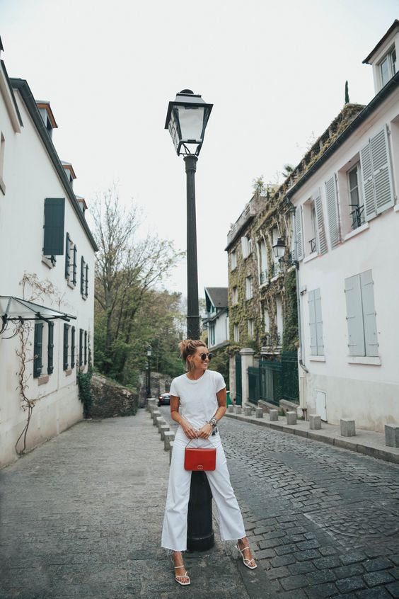 a white tee, wideleg pants, a red baguette bag and white square toe sandals for a simple summer outfit