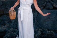 a white wrap midi dress with cap sleeves, a sash, neutral slippers and a basket bag for summer