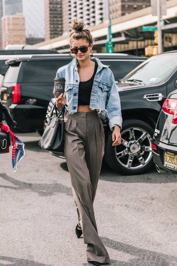 an edgy summer look with a black crop top, a blue denim cropped jacket, grey high waisted pants, black shoes and a bag