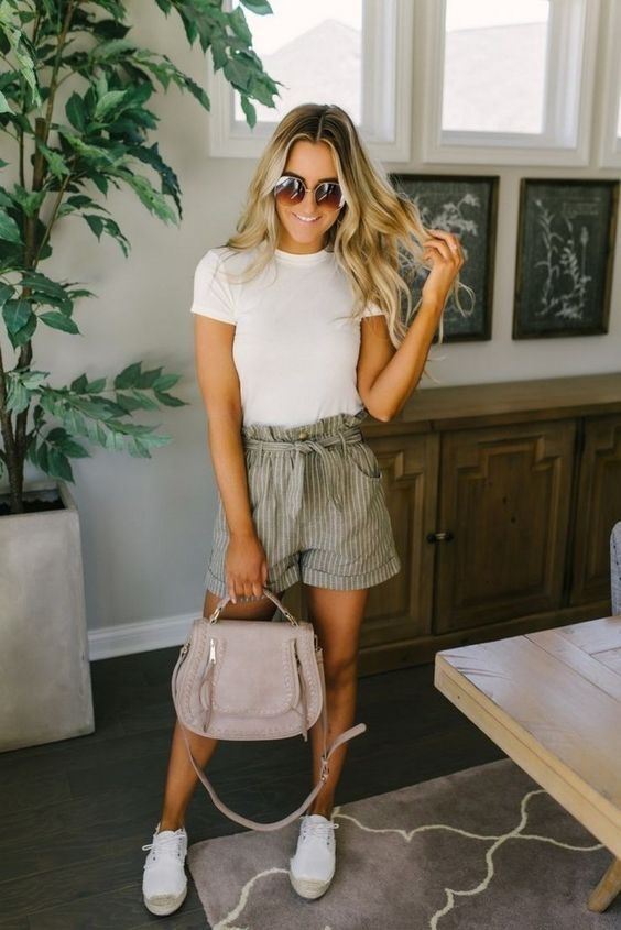 an everyday outfit with a white tee, grey striped shorts, a blush bag and white sneakers is very comfy