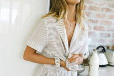 an oversized striped cotton romper with short sleeves is comfy to wear in summer
