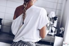 grey shorts and a white one shoulder oversized top for a chic casual look