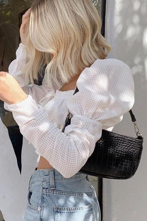 high waisted jeans, a white puff sleeve crop blouse and a black baguette bag for a date look