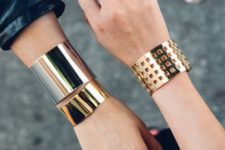 statement bracelets in gold and silver with a bold minimalist design look really edgy
